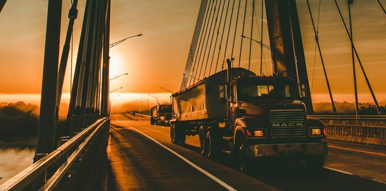 Truck on the bridge in sunset