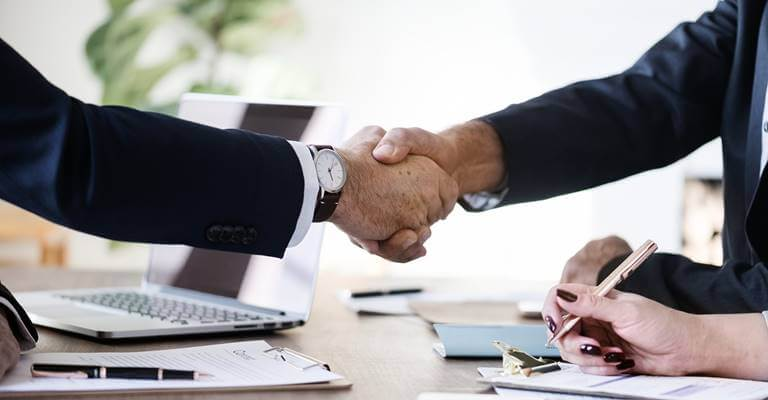 Two people are handshaking